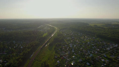 Aerial scene with countryside and moving train, Russia Live Action