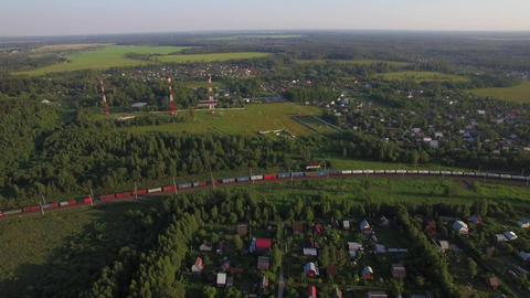 Summer houses in the countryside and freight train, aerial view Footage