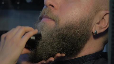 Brushing beard in barbershop Footage