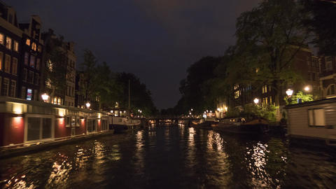 Timelapse of boat tour on Amsterdam canals at night Footage