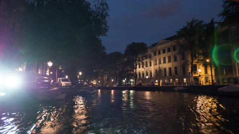 Timelapse of traveling on Amsterdam canals at night Footage