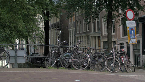 Bicycles parked on the bridge in Amsterdam Footage