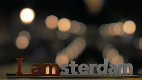 Amsterdam slogan and night city lights Image