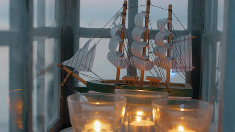 Outdoor lantern with ship model and candles Live Action
