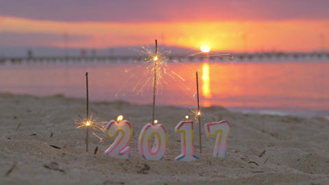Sparklers and candles 2017 on the beach Live Action