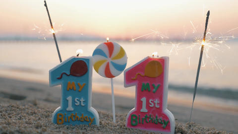 Twins birthday candles and sparklers on the beach Footage