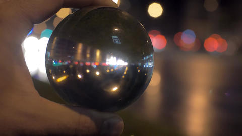 Looking at night city through glass ball Footage