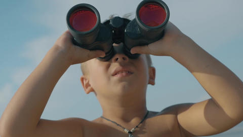 Child exploring the world with binoculars Footage