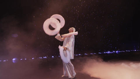 Circus performer juggling with three big white rings, Moscow, Russia Footage