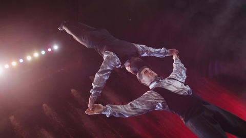 Close up view of acrobats making act with against colorful fountains, Moscow, Footage