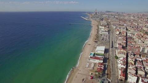 Aerial view of beach, sea, railways and hotels, Barcelona, Spain Live Action