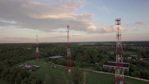 View of forest, country houses and base stations against blue sky with clouds in Footage