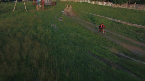 Aerial view of boy riding a bike at summer, Russia Image