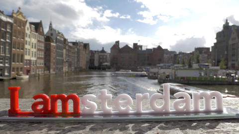 View of small plastic figure of Iamsterdam letters sculpture on the bridge again Filmmaterial