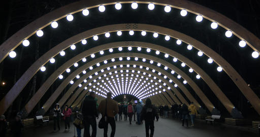 People walking in illuminated walkway of Park Sokolniki, Moscow Footage