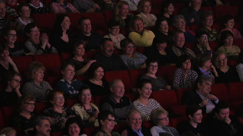 Laughing applauding people in movie hall Footage