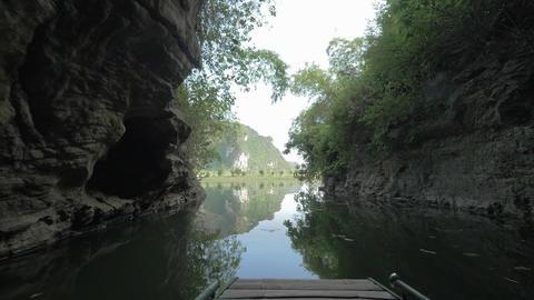 Boat sailing among limestone mountains in Ha Long Bay, Vietnam Footage