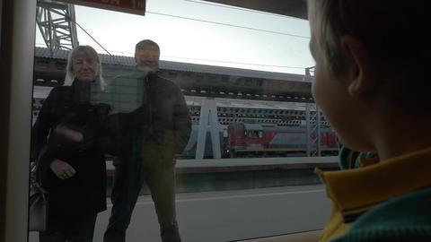 Slow motion in Saint-Petersburg, Russia little boy from the train window waving  Footage