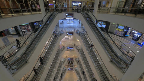 Seen a big multi-storey shopping centre with escalators and walking people Footage