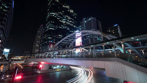 Timelapse of busy road and pedestrian overpass in night Bangkok Footage