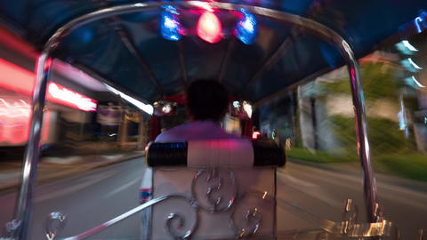 Timelapse of driving tuktuk in night Bangkok, Thailand Footage
