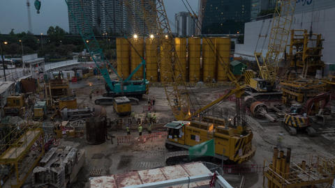 Timelapse of works on construction site in the evening Live Action