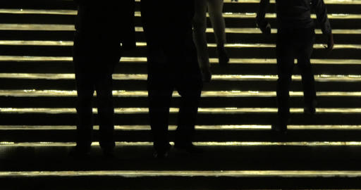 Silhouettes of people going up and down against lighting gold stairway. Bangkok, Footage