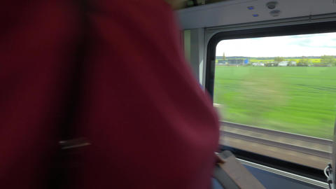 Woman taking her seat in the train Footage