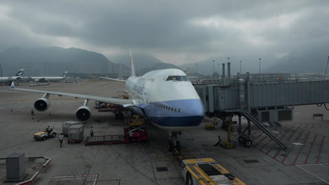 Timelapse of loading cargo into the plane. Hong Kong Airport Live Action