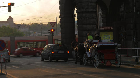 View of road intersection with red traffic light, cars, horse carriage and tram Live Action