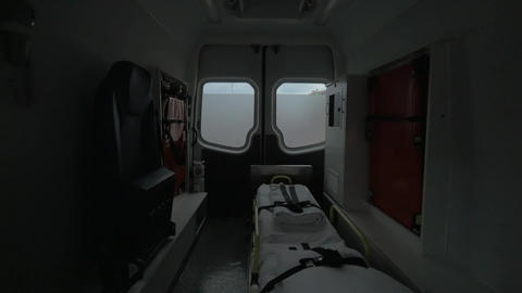 Internal view of a modern ambulance car riding on the street. Interior, modern s Footage