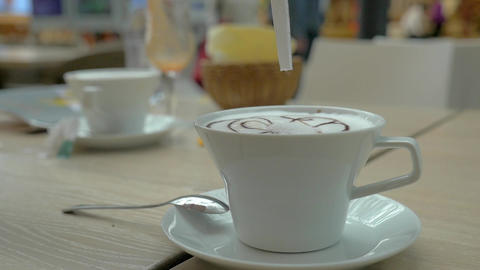 Adding sugar to the coffee served in cafe Footage