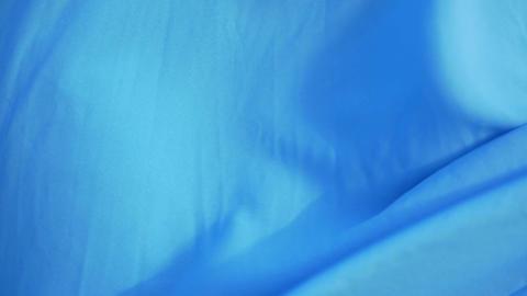 Blue fabric waving in the breeze ビデオ