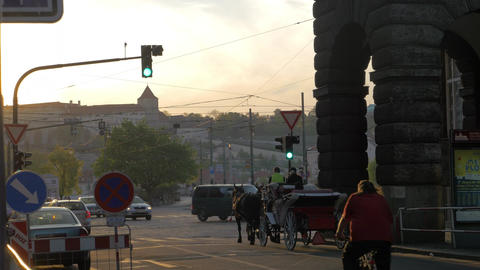 View of road intersection with red traffic light, cars, horse carriage and tram, Live Action