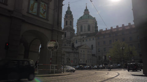 View of Saint Nicholas Church Old Town Square in Prague in sun day and road with Live Action