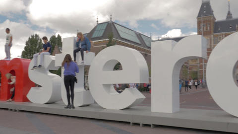 View of I Amsterdam sign and people on Amsterdam's Museumplein, Netherlands Live Action
