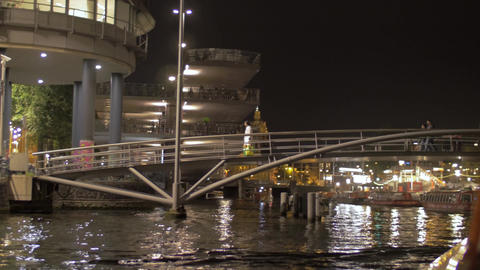 View of moving on the boat along Amstel river under pedestrian small bridge, Ams Footage