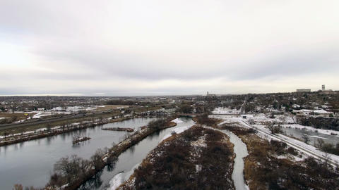 Aerial drone lift up to industrial ponds, pan left at 400 ft. elevation Footage