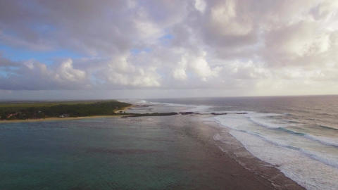 Aerial view of water line of seas that do not mix against blue sky with clouds,  Footage