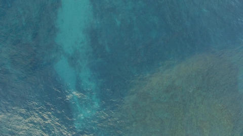 Aerial shot of blue ocean surface and foamy waves Footage