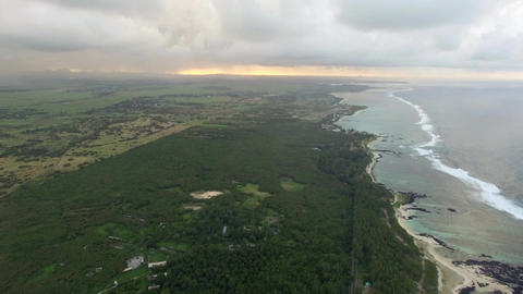 Aerial bird eye view of coast with sand beach and palm trees and water of Indian Footage
