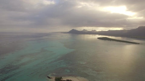 Aerial waterscape with ocean and distant mountains, Mauritius Footage