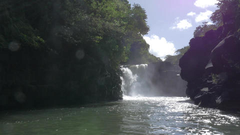 Waterfall and black volcanic rocks in Mauritius Footage