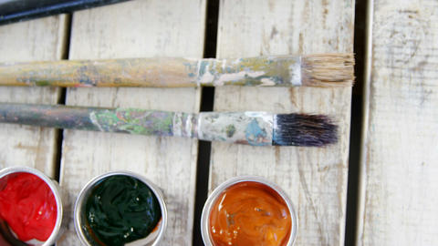 Various watercolor with paintbrush on wooden table Live Action