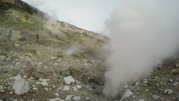 Natural volcanic hot springs erupting clouds of hot steam and gas Footage