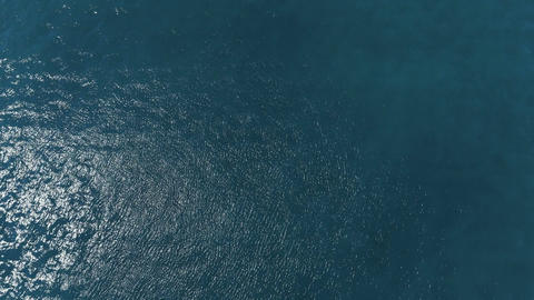 Slow motion fly over disturbed ocean water surface Animation