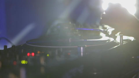 Female DJ in club plays on Vinyl Footage