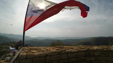 Ragged Russian flag fluttering on wind Footage