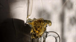 Honey is poured into the bottle neck ビデオ
