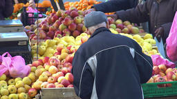 Old man choosing apples at local farmer's market, healthy organic food, trade Footage